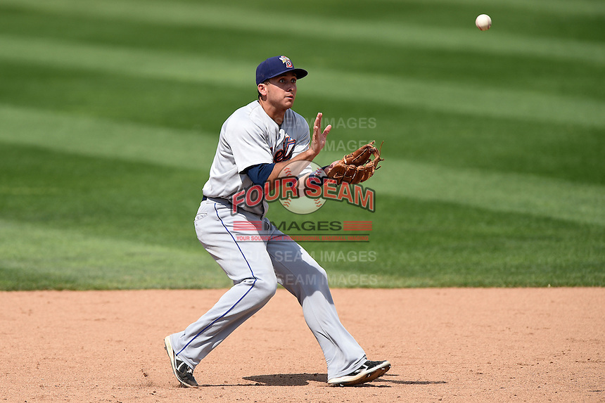 Binghamton Mets shortstop T.J. Rivera (5) fields a ground ball during a game against the Erie Seawolves on July 13, 2014 at Jerry Uht Park in Erie, Pennsylvania.  Binghamton defeated Erie 5-4.  (Mike Janes/Four Seam Images)