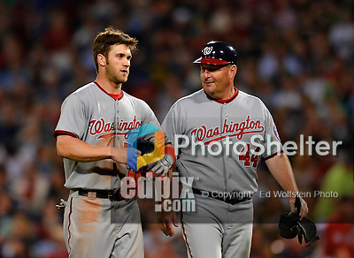 8 June 2012: Washington Nationals outfielder Bryce Harper is consoled by first base coach Trent Jewett after getting caught in a rundown by Dustin Pedroia in the 6th inning against the Boston Red Sox at Fenway Park in Boston, MA. The Nationals defeated the Red Sox 7-4 in the opening game of their 3-game series. Mandatory Credit: Ed Wolfstein Photo