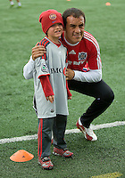 16 May 09: Chicago Fire midfielder Cuauhtemoc Blanco #10 takes the time to pose with a young fan during the warm-up at BMO Field in a game between the Chicago Fire and Toronto FC..Chicago Fire won 2-0..