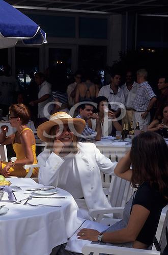 Rio de Janeiro, Brazil. Wealthy socialites at the Copacabana Palace Hotel for the Saturday Feijoada.