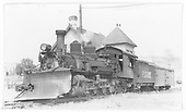 Pilot-end, fireman side view of RGS K-27 #455 with snow plow at the Ridgway depot.<br /> RGS  Ridgway, CO  Taken by Maxwell, John W. - 9/5/1950