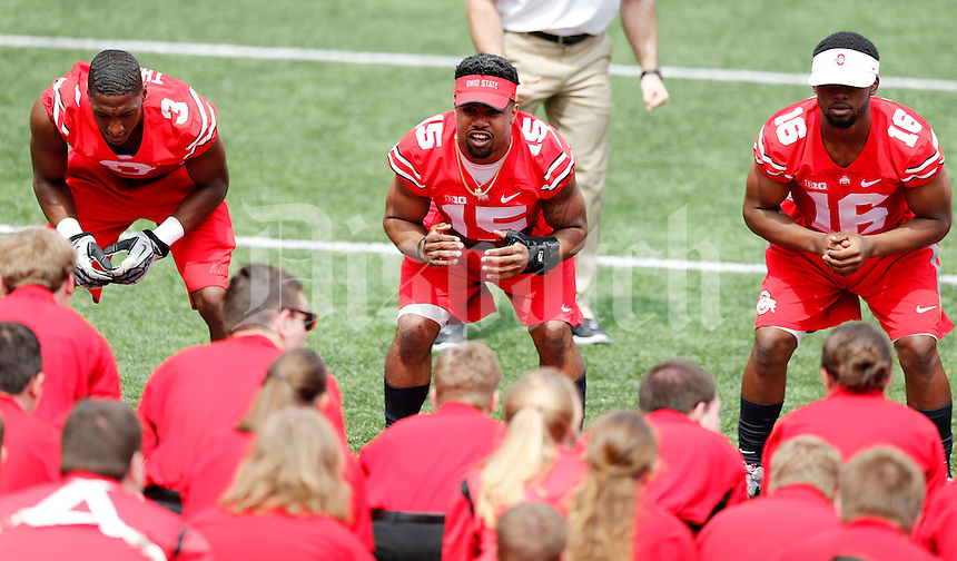 OSU players, Ezekiel Elliot does quick cals with the OSU Athletic Band before the Ohio State Spring Football Game Saturday, April 18 2015.  (Dispatch Photo by Courtney Hergesheimer)