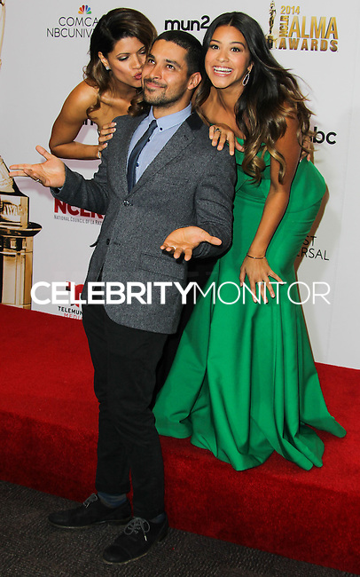 PASADENA, CA, USA - OCTOBER 10: Andrea Navedo, Wilmer Valderrama, Gina Rodriguez pose in the press room at the 2014 NCLR ALMA Awards held at the Pasadena Civic Auditorium on October 10, 2014 in Pasadena, California, United States. (Photo by Celebrity Monitor)