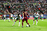 21 June 2006: Luis Figo (POR) (7) dribbles against the Mexican defense in front of a full house at Veltins Arena. Portugal defeated Mexico 2-1 at Veltins Arena in Gelsenkirchen, Germany in match 39, a Group D first round game, of the 2006 FIFA World Cup.  With the win, Portugal won the group, but both teams will advance to second round play.