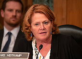 """United States Senator Heidi Heitkamp (Democrat of North Dakota) questions the witnesses during the US Senate Committee on Banking, Housing and Urban Affairs hearing titled """"Implementation of the Economic Growth, Regulatory Relief, and Consumer Protection Act"""" on Capitol Hill in Washington, DC on Tuesday, October 2, 2018.<br /> Credit: Ron Sachs / CNP"""