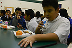 Fifth graders in Ms. Heidy's class enjoy their school lunch in the cafeteria at the Nathanael Greene Elementary School in the McKinley Park neighborhood in Chicago, Illinois on December 19, 2014.  All but one student in Ms. Heidy's class receives food assistance in the form of the Supplemental Nutritional Assistance Program or SNAP, which includes a free lunch.
