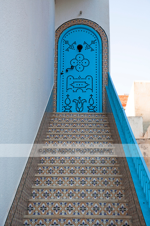 Le Kef, the capital of Western Tunisia, is an interesting town speckled with winding alleys, whitewashed walls, and sea blue wooden doors decorated in traditional Tunisian fashion.