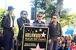 LOS ANGELES - OCT 30: Perry Farrell, Stephen Perkins, Chris Chaney, Dave Navarro at a ceremony where 'Jane's Addiction' was honored with a star on the Hollywood Walk of Fame on October 30, 2013 in Los Angeles, California