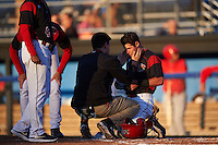 Batavia Muckdogs trainer Eric Reiglsberger looks at Aaron Knapp (5) after getting hit in the head with a pitch during a game against the Williamsport Crosscutters on September 1, 2016 at Dwyer Stadium in Batavia, New York.  Williamsport defeated Batavia 10-3. (Mike Janes/Four Seam Images)