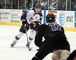 SIOUX FALLS, SD - JANUARY 1: Marcus Perrier #24 of the Sioux Falls Stampede looks to looks at defender Colten St.Clair #17 from the Fargo Force in the first period of their game Saturday night at the Arena. (Photo by Dave Eggen/Inertia)