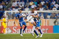 Trinidad and Tobago forward Darryl Roberts (12) plays the ball under pressure from El Salvador midfielder Jaime Alas (16) during a CONCACAF Gold Cup group B match at Red Bull Arena in Harrison, NJ, on July 8, 2013.