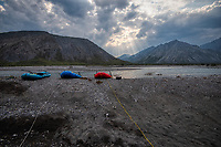 A late June/early July rafting trip down the Marsh Fork of the Canning River through the Brooks Range in Alaska's Arctic National Wildlife Refuge features summer weather, moderate rapids, clear waters, great camping and awesome scenery. The sun breaks through the clouds in the evening at a camp about mid-way through the trip.