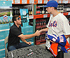Steven Matz, New York Mets pitcher and Stony Brook native who graduated from Ward Melville High School in 2009, shakes hands with Eric Shuster, 14, of Holbrook before signing his jersey at Holbrook Liquors, located at 125 Beacon Drive, on Monday, Aug. 8, 2016.