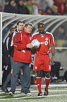 Toronto FC head coach John Carver talks with defender Marvell Wynne (16) before a throw in. Toronto FC and the New York Red Bulls played to a 1-1 tie during a Major League Soccer match at BMO Field in Toronto, Ontario, Canada, on May 1, 2008.