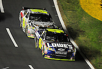 Oct. 17, 2009; Concord, NC, USA; NASCAR Sprint Cup Series driver Jimmie Johnson (48) leads Jeff Gordon (24) during the NASCAR Banking 500 at Lowes Motor Speedway. Mandatory Credit: Mark J. Rebilas-