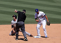 25th July 2020, Los Angeles, California, USA;  Los Angeles Dodgers shortstop Corey Seager (5) reacts after tagging out San Francisco Giants infield erAustin Slater (13)  during the game against the San Francisco Giants on July 25, 2020, at Dodger Stadium in Los Angeles, CA.