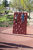 Two girls on a climbing wall at the Queen Elizabeth Olympic Park, Stratford.