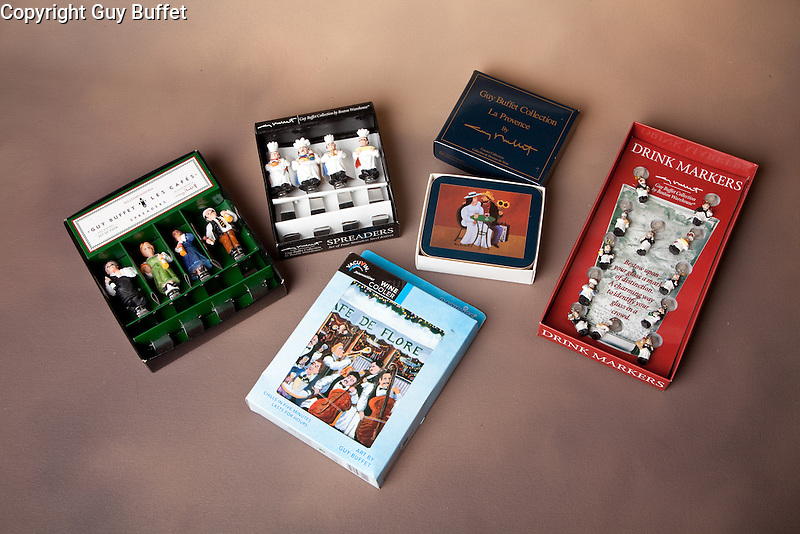 The Guy Buffet Collection c<br /> Variety of licensed products;<br /> butter spreaders, coasters, wine chillers, wine markers.<br /> <br /> No longer available.