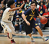 Nicholas Schneidler #5 of Massapequa, right, gets pressured by Kamani Jones #40 of Baldwin during the Nassau County varsity boys basketball Class AA semifinals at Farmingdale State College on Monday, Feb. 26, 2018. Baldwin won by a score of 50-41.