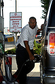 """Rockville, MD - October 14, 2002 -- George Tolson of Rockville, MD refuses to be frightened away by the attacks of the """"Beltway Sniper"""" as he fulls his car at Parklawn Texaco in Rockville on 14 October, 2002. Parklawn Texaco is one of the busiest stations in Montgomery County, MD.  It is very close to the Fitzgerald Auto-Mall, where Sonny Callahan was killed by the """"Beltway Sniper"""" on 3 October, 2002.<br /> Credit: Ron Sachs / CNP <br /> (RESTRICTION: NO New York or New Jersey Newspapers or newspapers within a 75 mile radius of New York City)"""