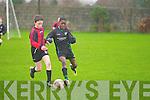 Kingdom Boys Kevin Williams and Mastergeeha FC's Cian Fahy.