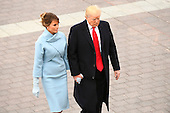 United States President Donald Trump and Melania Trump walk back after escorting former President Barack Obama and Michelle Obama to Marine One during the 2017 Presidential Inauguration at the US Capitol in Washington, DC on January 20, 2017.<br /> Credit: Jack Gruber / Pool via CNP