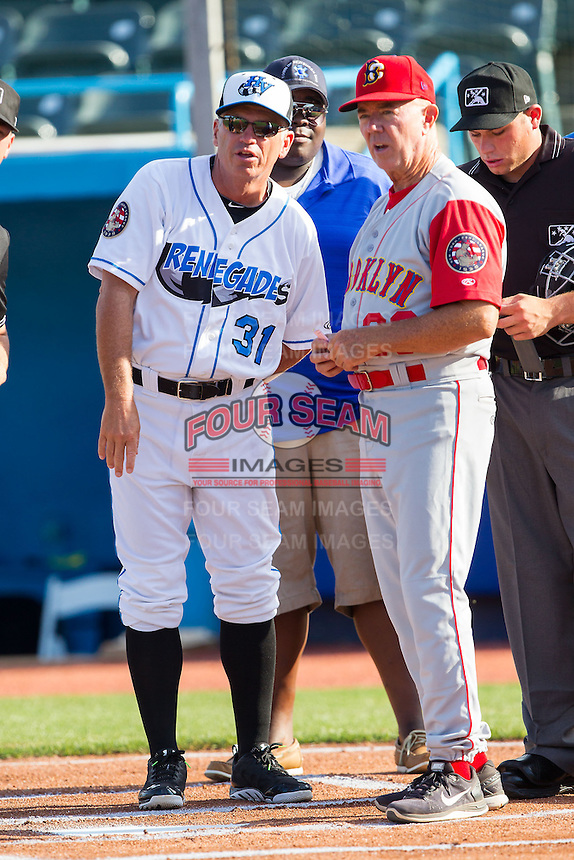 Hudson Valley Renegades manager Tim Parenton (31) goes over the grounds rules with Brooklyn Cyclones manager Tom Gamboa (20) at Dutchess Stadium on June 18, 2014 in Wappingers Falls, New York.  The Cyclones defeated the Renegades 4-3 in 10 innings.  (Brian Westerholt/Four Seam Images)