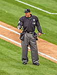 1 April 2013: MLB Home Plate Umpire Jeff Kellogg signals a lineup change during the Opening Day Game between the Miami Marlins and the Washington Nationals at Nationals Park in Washington, DC. The Nationals shut out the Marlins 2-0 to launch the 2013 season. Mandatory Credit: Ed Wolfstein Photo *** RAW (NEF) Image File Available ***