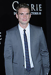 Alex Russell arriving to the World Premiere of Carrie held at the Arclight Cinemas in Los Angeles, Ca. October 7, 2013.