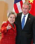 Washington, D.C. - May 24, 2007 -- United States President George W. Bush poses with Chinese Vice Premier Wu Yi, special envoy of Chinese President Hu Jintao, prior to the meeting of the United States - China Strategic Economic Dialogue at the White House in Washington, D.C. on Thursday, May 24, 2007.  The U.S. - China Strategic Economic Dialogue promotes economic cooperation and the growth of U.S. - China relations..Credit: Ron Sachs / CNP