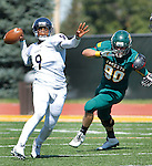 SEPTEMBER 13, 2014 -- Trenton McKinney #9 of South Dakota Mines readies his pass while pursued by Boone Bowker #90 of Black Hills State during their college football game Saturday at Lyle Hare Stadium in Spearfish, S.D.  (Photo by Dick Carlson/Inertia)