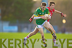 Thomas Ladden of Kerry shakes off Cork's Aidan Walsh in the Munster U21 Football Championship Final held on Wednesday night in Pairc Ui Rinn Cork.