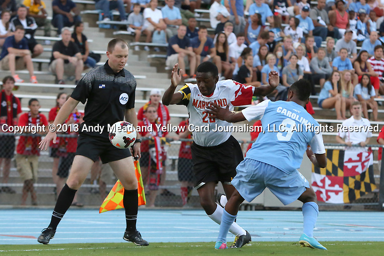 13 September 2013: Maryland's Chris Odoi-Atsem (28) and North Carolina's Jordan McCrary (9). The University of North Carolina Tar Heels hosted the University of Maryland Terrapins at Fetzer Field in Chapel Hill, NC in a 2013 NCAA Division I Men's Soccer match. The game ended in a 2-2 tie after two overtimes.