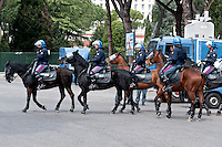 Police on horseback riot outside the stadium during  the Serie A match between SS Lazio and AS Roma at Stadio Olimpico to prevent violence among the fans of the two teams on April 3, 2016 in Rome, Italy. Debut of the mounted units of the State Police and Carabinieri for public order management.