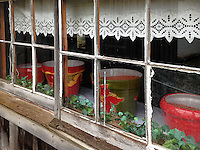A window reveals pots waiting to be planted with spring flowers or herbs, Bille Creek Village, a historic re-creation of nineteenth century life in Indiana, Rockville, Indiana