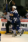 March 13, 2009:  Randall Gelech (42) of the Rochester Amerks is checked by Ryan Hamilton (12) of the Toronto Marlies in the first period during a game at the Blue Cross Arena in Rochester, NY.  Toronto defeated Rochester 4-2.  Photo copyright Mike Janes Photography 2009