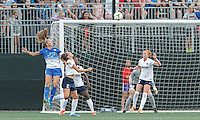Allston, Massachusetts - August 8, 2015: In a National Women's Soccer League (NWSL) match, Boston Breakers (blue) defeated Washington Spirit (white/black), 2-1, at Soldiers Field Soccer Stadium.<br /> Julie King scores with a head ball.
