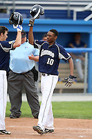 April 15,2010:  Shortstop John Polonius (10) of the Genesee Community College (GCC) Cougars Men's Baseball Team after hitting a home run over the center field wall vs. Alfred State at Dwyer Stadium in Batavia, NY.  Photo Copyright Mike Janes Photography 2010