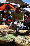 woman eating avocado at the Analakely market in Antananarivo in Madagascar