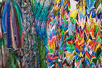Kyoto City, Japan<br /> Colorful origami cranes offered by students at Fushimi Inari Shrine (Shinto)<br /> 1000 cranes