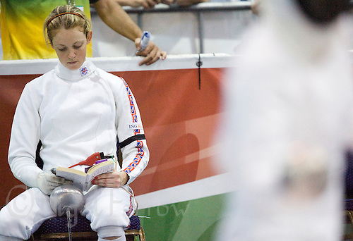 31 MAY 2008 - BUDAPEST, HUN - Katy Livingston (GBR) tries to avoid distractions by reading a book - Modern Pentathlon World Championships. (PHOTO (C) NIGEL FARROW)