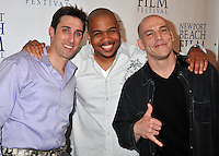 "PAUL J. ALESSI, producer/actor & OMAR GOODING & STEVEN GASWIRTH.""Knuckle Draggers"" Premiere at the 2009 Newport Beach Film Festival held at Edwards Cinemas, Newport Beach, CA, USA..April 27th, 2009.half length red dress white shirt purple black hands .CAP/ADM/BP.©Byron Purvis/AdMedia/Capital Pictures."