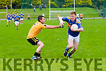St. Senan's V Asdee: St. Senan's Sean Weir gets away from Asdee's Brian Coughlan in the novice  semi-final clash at Finuge on Sunday morning last.