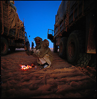 Sahara desert, Libya-Chad, November/December 2004..Every week, a convoy of 40 privately owned Libyan trucks loaded by the WFP with about 1000 metric tons of western food aid cross 2500 km of deep desert across Libya and Chad to reach more than 200 000 refugees from Darfur in camps near the Sudanese border.