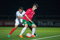 Iliyan Stefano (Bari) of Bulgaria U19 holds off Easah Suliman (Cheltenham Town on loan from Aston Villa) of England U19 during the International friendly match between England U19 and Bulgaria U19 at Adams Park, High Wycombe, England on 10 October 2016. Photo by Andy Rowland.