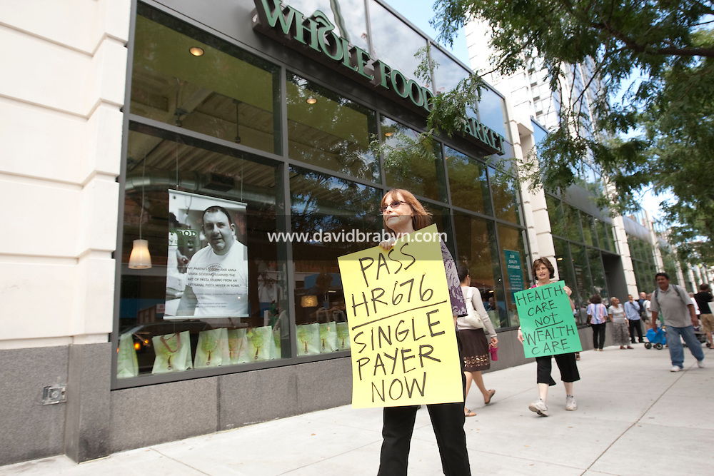 Single-payer activists picket the new Whole Foods store on Columbus Avenue in New York, USA, 26 August 2009, to protest the store's CEO John Mackey's criticism of President Barack Obama's health care plan..Health care reform supporters have called for a formal boycott of Whole Foods, the 10th largest food and drug store in the U.S..