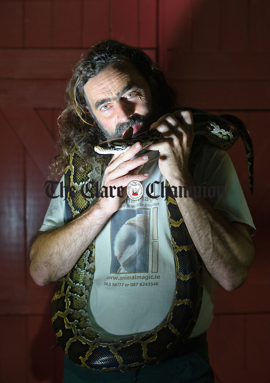 Denis Mc Carthy of Animal Magic with his Burmese python at the Bunratty Castle and Folk Park Halloween event this afternoon. See more Halloween photos on this week's Clare Champion on Thursday. Photograph by John Kelly.