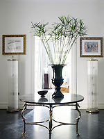 A table by Jansen, flanked by a pair of 1940s Italian floor lamps, is the focus of the entrance hall