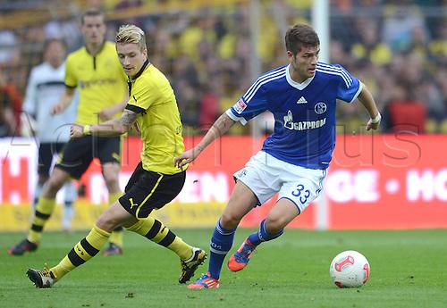 20.10.2012. Dortmund, Germany   Bundesliga  Borussia Dortmund versus FC Schalke 04. Marco Reuss left Borussia Dortmund against Novel Neustaedter FC Schalke 04