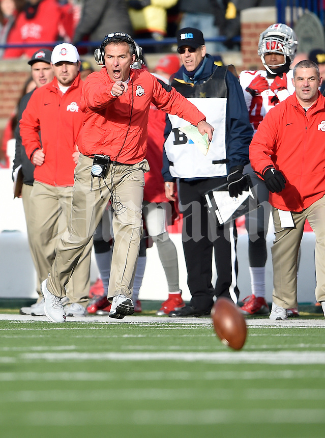 Ohio State Buckeyes head coach Urban Meyer reacts during a punt play in the fourth quarter of the college football game between the Michigan Wolverines and the Ohio State Buckeyes at Michigan Stadium in Ann Arbor, Saturday afternoon, November 28, 2015. The Ohio State Buckeyes defeated the Michigan Wolverines 42 - 13. (The Columbus Dispatch / Eamon Queeney)